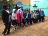 Grade 1 class welcoming visitors.JPG
